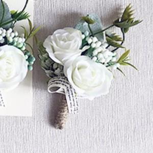 white bridal button holes page boys