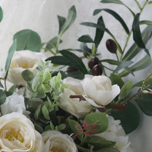 cream leafy bride flowers