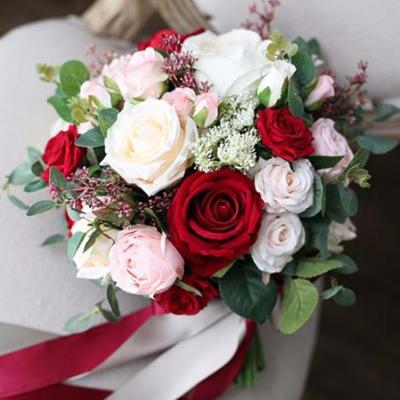 bride bouquet red pink white